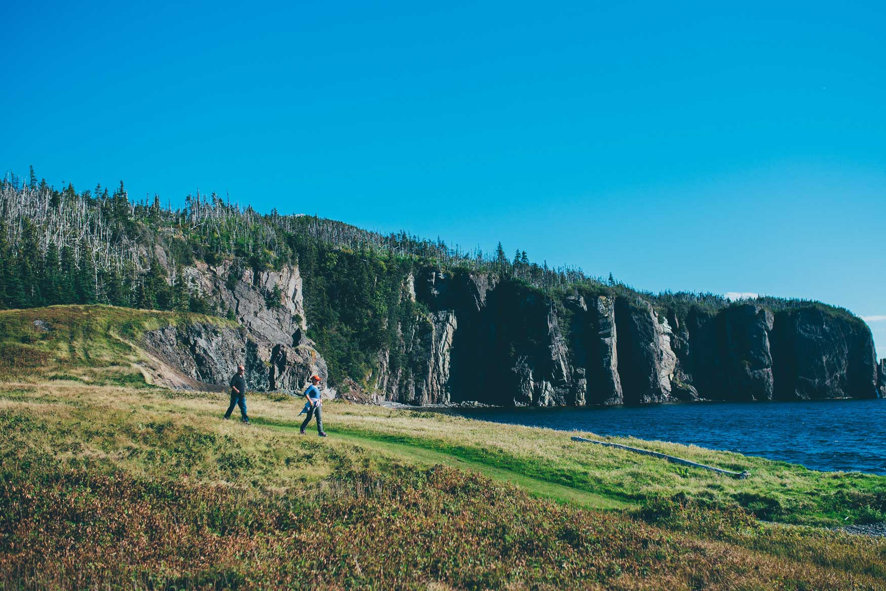 Two hikers walk the Skerwink Trail