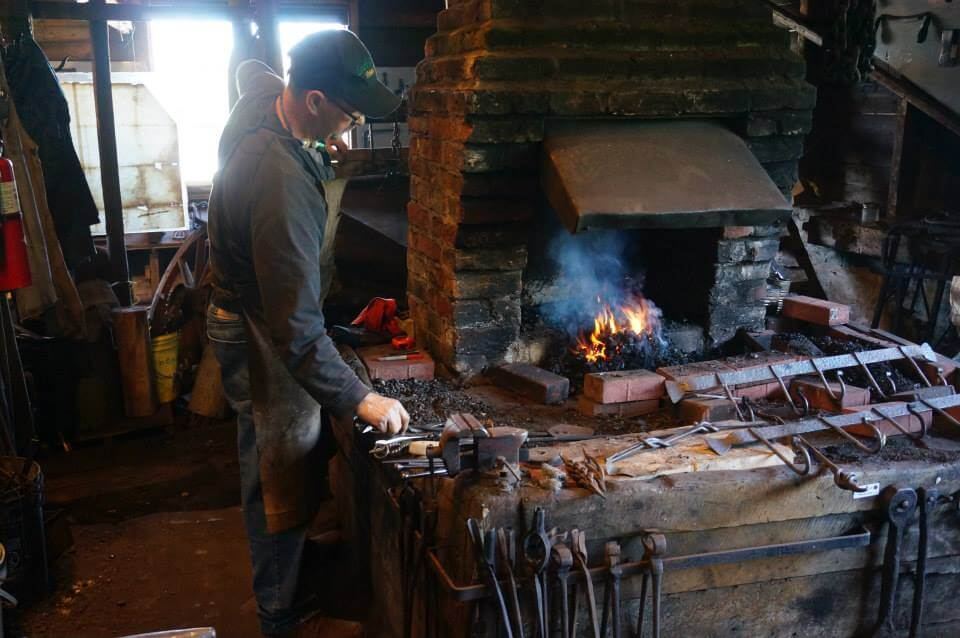 Blacksmith working in Trinity's Forge