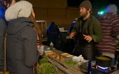 Chef Jeremy Charles explains his dish to a festival goer